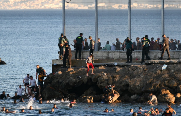 Morocco allows thousands of migrants to swim to the Spanish enclave of Ceuta