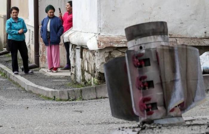 Armenia and Azerbaijan continue to shell towns despite cease fire